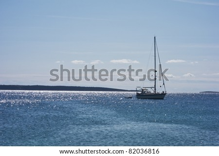 sailing boat in blue crystal water in croatia