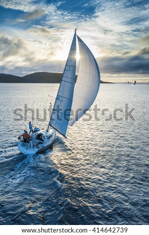 Sailing boat in light wind from bird`s eye view - stock photo