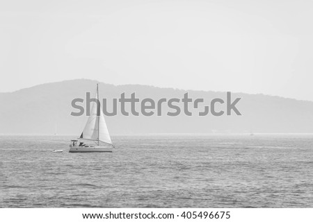 Sailing boat in the sea - black and white - stock photo