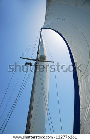 Sailing boat mainsail and headsail at Marina of Ravenna - stock photo