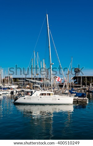 sailing boat mooring in barcelona harbour - stock photo