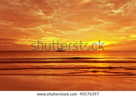 Sailing boat on a background of a beautiful sunset