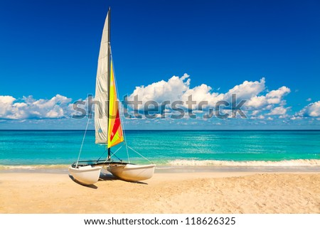 Sailing boat on a beautiful summer day at beach in Cuba - stock photo