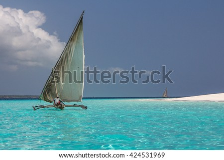 Sailing boat on the clear seas off the coast of Zanzibar. Zanzibar, Tanzania - 25/SEP/2015
