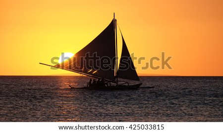 Sailing boat on the sea at the sunset at Boracay island Philippines - stock photo