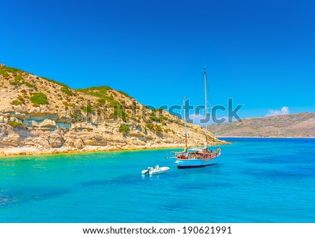 sailing boat out of the main port of Kalymnos island in Greece - stock photo