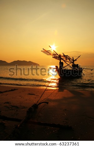 Sailing boat over to sunset, Thailand