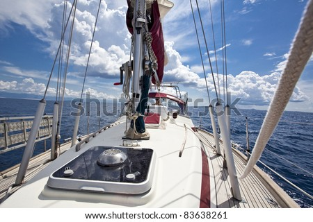 sailing boat pictured from on board - stock photo