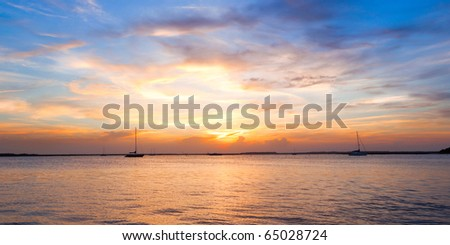 Sailing boat silhouette with sunset sky. Fernandina beach, Florida, USA - stock photo