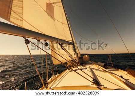 Sailing boat wide angle view in the sea at sunset, instagram toning - stock photo