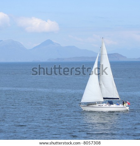 Sailing boat with Scottish Island on the horizon - stock photo