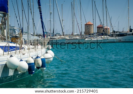 Sailing boat with very many fenders - stock photo
