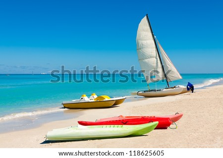Sailing boats and kayaks on the beautiful beach of Varadero in Cuba - stock photo