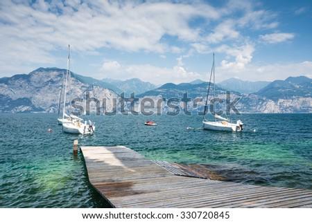 Sailing boats at Lake Garda (Italy) - stock photo