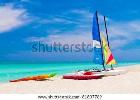 Sailing boats, catamarans, kayaks and water bikes in the beautiful cuban beach of Varadero - stock photo