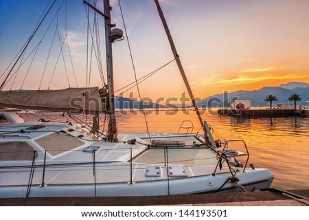 Sailing boats in marina at sunset. Tivat. Montenegro - stock photo