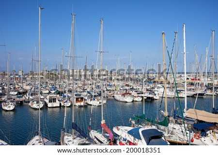 Sailing boats in Port Olimpic marina in the city of Barcelona, Catalonia, Spain. - stock photo