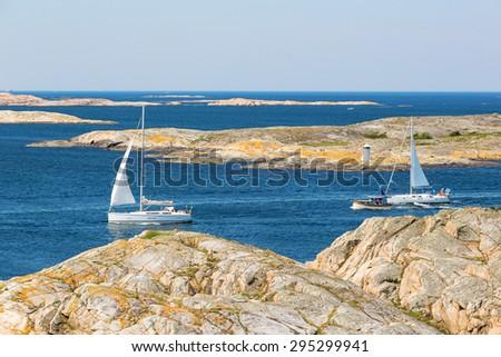 Sailing boats in rocky sea archipelago in the Swedish west coast - stock photo