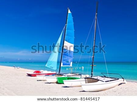 Sailing boats in the beautiful cuban beach of Varadero - stock photo