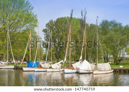 Sailing boats, moored at Beccles Quay, on the River Waveney. - stock photo