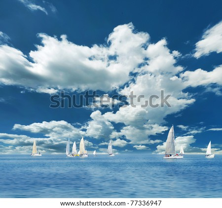Sailing boats on the sea and blue sky - stock photo