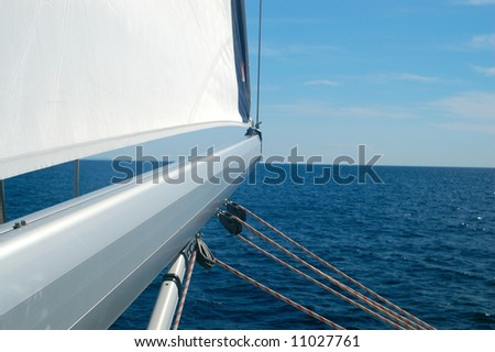 Sailing detail - mast pointing at open sea - stock photo