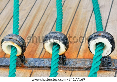 Sailing device with ropes on the sailboat - stock photo