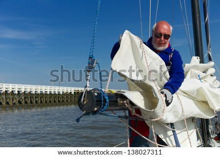 Sailing from the harbor of Nieuwpoort to Middelkerke and back. - stock photo