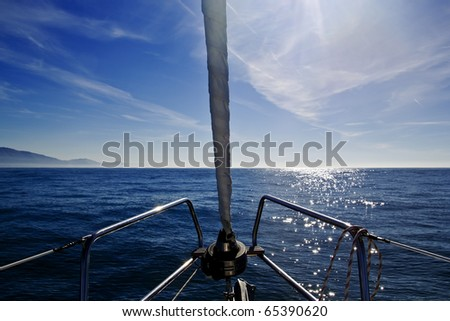 Sailing in a blue ocean - stock photo