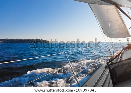 Sailing in a stiff breeze.  Copy space.