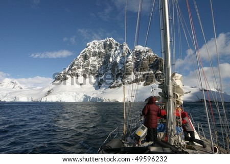 Sailing in Antartcica: Beautiful landscape in Antarctica. Some snow covered mountains. - stock photo