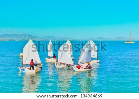 Sailing in Greece,Sail training of young children in Greek island - stock photo