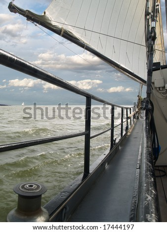 Sailing in stormy weather with a dark sky