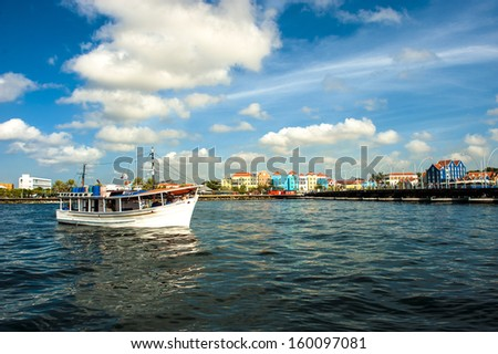 Sailing into the harbor at Willemstad in Curacao - stock photo