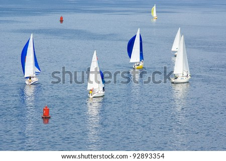 Sailing life on a summer river. - stock photo