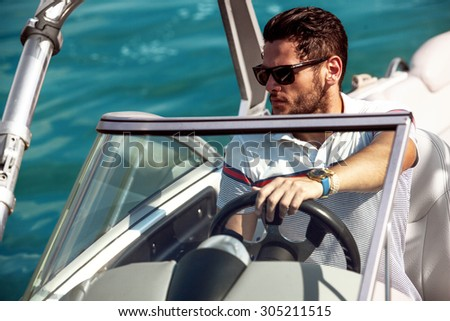 Sailing man on yacht in ocean - stock photo