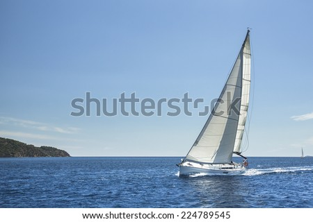 Sailing off the coast of Greece in the Aegean Sea. Luxury yachts. - stock photo