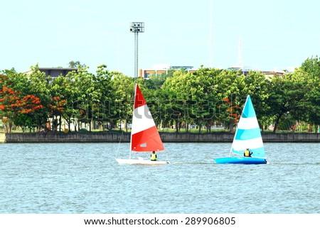 sailing on a small sail boat - stock photo