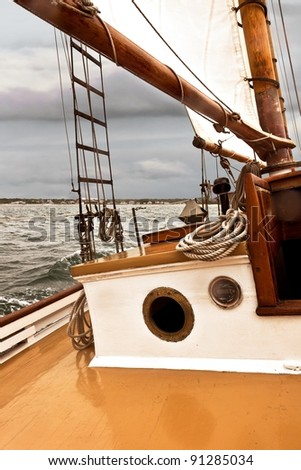 Sailing on a vintage wooden boat, a two masted schooner built in the 1920s - stock photo