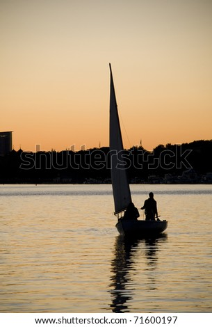 Sailing on the Charles River at Sunset. - stock photo