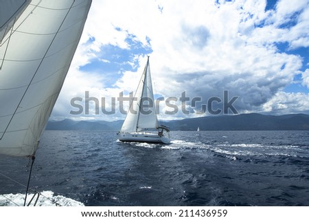 Sailing on the race in a stormy sea. - stock photo