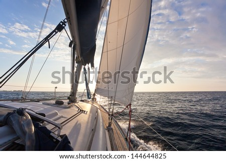 Sailing on yacht in to the sun - stock photo