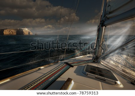 Sailing out of a storm before sunset at Cape St. Vincent, Portugal - stock photo