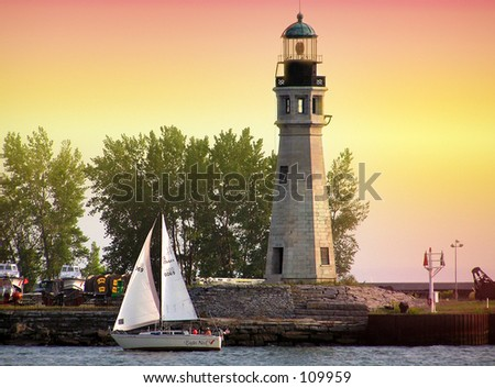Sailing Past the Lighthouse - stock photo