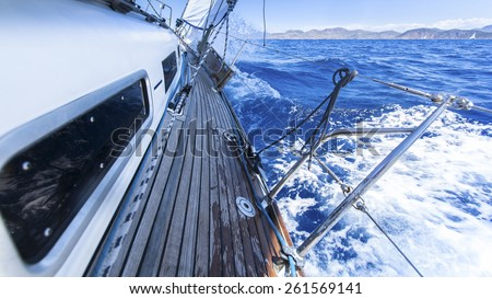 Sailing. Racing yacht in the Mediterranean sea on blue sky background. Luxury Lifestyle. - stock photo