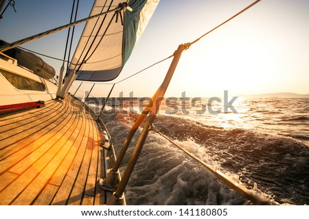 Sailing regatta, during sunset. - stock photo