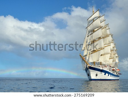 Sailing ship and rainbow - stock photo