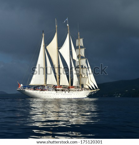 Sailing ship and stormy sky - stock photo