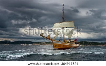 Sailing ship at high speed before the storm. Yachting. Sailing.  Sailboat. - stock photo