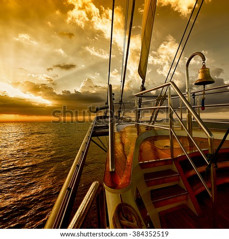 Sailing ship at sunset in the sea. Instagram effect. Yachting. Sailing - stock photo